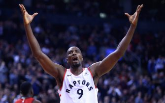 TORONTO, ON - MARCH 5:  Serge Ibaka #9 of the Toronto Raptors reacts during the second half of an NBA game against the Houston Rockets at Scotiabank Arena on March 5, 2019 in Toronto, Canada.  NOTE TO USER: User expressly acknowledges and agrees that, by downloading and or using this photograph, User is consenting to the terms and conditions of the Getty Images License Agreement.  (Photo by Vaughn Ridley/Getty Images)