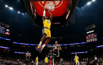 ATLANTA, GEORGIA - DECEMBER 15:  LeBron James #23 of the Los Angeles Lakers dunks against the Atlanta Hawks in the first half at State Farm Arena on December 15, 2019 in Atlanta, Georgia.  NOTE TO USER: User expressly acknowledges and agrees that, by downloading and/or using this photograph, user is consenting to the terms and conditions of the Getty Images License Agreement.  (Photo by Kevin C. Cox/Getty Images)