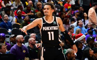 ATLANTA, GA - DECEMBER 15: Trae Young #11 of the Atlanta Hawks smiles during a game against the Los Angeles Lakers on December 15, 2019 at State Farm Arena in Atlanta, Georgia.  NOTE TO USER: User expressly acknowledges and agrees that, by downloading and/or using this Photograph, user is consenting to the terms and conditions of the Getty Images License Agreement. Mandatory Copyright Notice: Copyright 2019 NBAE (Photo by Scott Cunningham/NBAE via Getty Images)