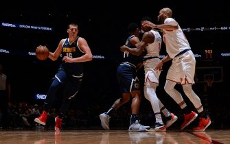 DENVER, CO - DECEMBER 15: Nikola Jokic #15 of the Denver Nuggets handles the ball against the New York Knicks on December 15, 2019 at the Pepsi Center in Denver, Colorado. NOTE TO USER: User expressly acknowledges and agrees that, by downloading and/or using this Photograph, user is consenting to the terms and conditions of the Getty Images License Agreement. Mandatory Copyright Notice: Copyright 2019 NBAE (Photo by Bart Young/NBAE via Getty Images)