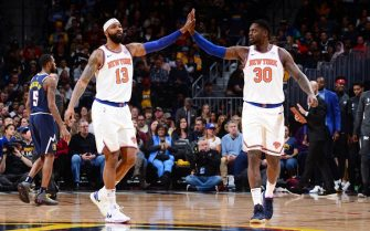 DENVER, CO - DECEMBER 15: Marcus Morris Sr. #13 of the New York Knicks and Julius Randle #30 of the New York Knicks high-five during a game against the Denver Nuggets on December 15, 2019 at the Pepsi Center in Denver, Colorado. NOTE TO USER: User expressly acknowledges and agrees that, by downloading and/or using this Photograph, user is consenting to the terms and conditions of the Getty Images License Agreement. Mandatory Copyright Notice: Copyright 2019 NBAE (Photo by Bart Young/NBAE via Getty Images)