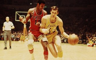 INGLEWOOD, CA - 1971:  Jerry West #44 of the Los Angeles Lakers dribbles against Hal Greer #15 of the Philadelphia 76ers at the Great Western Forum in Inglewood, California circa 1971. NOTE TO USER: User expressly acknowledges and agrees that, by downloading and or using this photograph, User is consenting to the terms and conditions of the Getty Images License Agreement. Mandatory Copyright Notice: Copyright 1971 NBAE (Photo by Wen Roberts/NBAE via Getty Images)