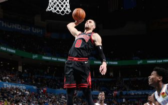 OKLAHOMA CITY, OK- DECEMBER 16: Zach LaVine #8 of the Chicago Bulls goes up for a dunk during a game against the Oklahoma City Thunder on December 16, 2019 at Chesapeake Energy Arena in Oklahoma City, Oklahoma. NOTE TO USER: User expressly acknowledges and agrees that, by downloading and or using this photograph, User is consenting to the terms and conditions of the Getty Images License Agreement. Mandatory Copyright Notice: Copyright 2019 NBAE (Photo by Zach Beeker/NBAE via Getty Images)