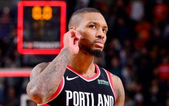 PHOENIX, AZ - DECEMBER 16: Damian Lillard #0 of the Portland Trail Blazers looks on during the game against the Phoenix Suns on December 16, 2019 at Talking Stick Resort Arena in Phoenix, Arizona. NOTE TO USER: User expressly acknowledges and agrees that, by downloading and or using this photograph, user is consenting to the terms and conditions of the Getty Images License Agreement. Mandatory Copyright Notice: Copyright 2019 NBAE (Photo by Barry Gossage/NBAE via Getty Images)