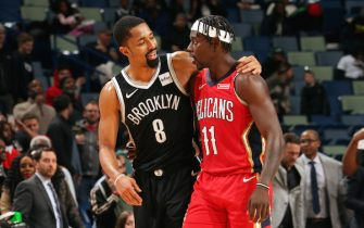 NEW ORLEANS, LA - DECEMBER 17: Spencer Dinwiddie #8 of the Brooklyn Nets talks to Jrue Holiday #11 of the New Orleans Pelicans after the game on December 17, 2019 at the Smoothie King Center in New Orleans, Louisiana. NOTE TO USER: User expressly acknowledges and agrees that, by downloading and or using this Photograph, user is consenting to the terms and conditions of the Getty Images License Agreement. Mandatory Copyright Notice: Copyright 2019 NBAE (Photo by Layne Murdoch Jr./NBAE via Getty Images)
