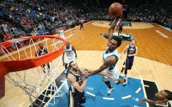 MINNEAPOLIS, MN -  MARCH 26:  Andrew Wiggins #22 of the Minnesota Timberwolves goes up for a dunk against the Utah Jazz on March 26, 2016 at Target Center in Minneapolis, Minnesota. NOTE TO USER: User expressly acknowledges and agrees that, by downloading and or using this Photograph, user is consenting to the terms and conditions of the Getty Images License Agreement. Mandatory Copyright Notice: Copyright 2016 NBAE (Photo by David Sherman/NBAE via Getty Images)