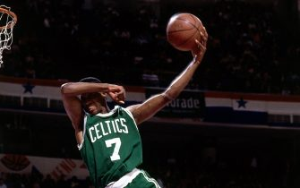 MIAMI - 1990: Dee Brown#7 of the Boston Celtics goes up for a no look slam dunk in the Slam Dunk Contest during the 1990 NBA All-Star Weekend at The Miami Arena in Miami, Floria.  NOTE TO USER: User expressly acknowledges  and agrees that, by downloading and or using this  photograph, User is consenting to the terms and conditions of the Getty Images License Agreement.  (Photo by Nathaniel S. Butler/ NBAE/ Getty Images)