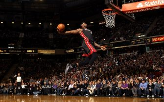 SACRAMENTO, CA - DECEMBER 27:  LeBron James #6 of the Miami Heat dunks the ball during their game against the Sacramento Kings at Sleep Train Arena on December 27, 2013 in Sacramento, California. NOTE TO USER: User expressly acknowledges and agrees that, by downloading and or using this photograph, User is consenting to the terms and conditions of the Getty Images License Agreement.  (Photo by Ezra Shaw/Getty Images)