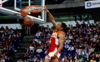DALLAS - FEBRUARY 8:  Spud Webb #4 of the Atlanta Hawks dunks during the 1986 Slam Dunk Contest on February 8, 1986 at Reunion Arena in Dallas, Texas.  NOTE TO USER: User expressly acknowledges that, by downloading and or using this photograph, User is consenting to the terms and conditions of the Getty Images License agreement. Mandatory Copyright Notice: Copyright 1986 NBAE (Photo by Andrew D. Bernstein/NBAE via Getty Images)