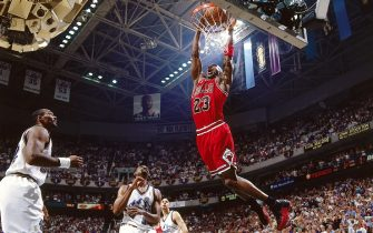 SALT LAKE CITY - JUNE 6:  Michael Jordan #23 of the Chicago Bulls dunks the ball against the Utah Jazz  during Game three of the 1997 NBA Finals at the Delta Center on June 6, 1997 in Salt Lake City, Utah.  NOTE TO USER: User expressly acknowledges and agrees that, by downloading and/or using this Photograph, User is consenting to the terms and conditions of the Getty Images License Agreement.  Mandatory Copyright Notice:  Copyright 1996 NBAE  (Photo by Nathaniel S. Butler/NBAE via Getty Images)
