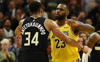 MILWAUKEE, WISCONSIN - DECEMBER 19:  Giannis Antetokounmpo #34 of the Milwaukee Bucks and LeBron James #23 of the Los Angeles Lakers hug following a game at Fiserv Forum on December 19, 2019 in Milwaukee, Wisconsin. NOTE TO USER: User expressly acknowledges and agrees that, by downloading and or using this photograph, User is consenting to the terms and conditions of the Getty Images License Agreement. (Photo by Stacy Revere/Getty Images)