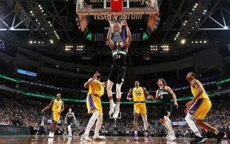 MILWAUKEE, WI - DECEMBER 19: Giannis Antetokounmpo #34 of the Milwaukee Bucks dunks the ball against the Los Angeles Lakers on December 19, 2019 at the Fiserv Forum Center in Milwaukee, Wisconsin. NOTE TO USER: User expressly acknowledges and agrees that, by downloading and or using this Photograph, user is consenting to the terms and conditions of the Getty Images License Agreement. Mandatory Copyright Notice: Copyright 2019 NBAE (Photo by Joe Murphy/NBAE via Getty Images).