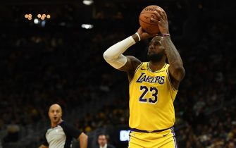MILWAUKEE, WISCONSIN - DECEMBER 19:  LeBron James #23 of the Los Angeles Lakers takes a three point shot during the second half of a game against the Milwaukee Bucks at Fiserv Forum on December 19, 2019 in Milwaukee, Wisconsin. NOTE TO USER: User expressly acknowledges and agrees that, by downloading and or using this photograph, User is consenting to the terms and conditions of the Getty Images License Agreement. (Photo by Stacy Revere/Getty Images)