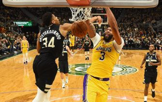 MILWAUKEE, WISCONSIN - DECEMBER 19:  Anthony Davis #3 of the Los Angeles Lakers dunks over Giannis Antetokounmpo #34 of the Milwaukee Bucks during the second half of a game at Fiserv Forum on December 19, 2019 in Milwaukee, Wisconsin. NOTE TO USER: User expressly acknowledges and agrees that, by downloading and or using this photograph, User is consenting to the terms and conditions of the Getty Images License Agreement. (Photo by Stacy Revere/Getty Images)