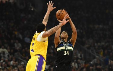 MILWAUKEE, WISCONSIN - DECEMBER 19:  Giannis Antetokounmpo #34 of the Milwaukee Bucks shoots over Anthony Davis #3 of the Los Angeles Lakers during the first half of a game at Fiserv Forum on December 19, 2019 in Milwaukee, Wisconsin. NOTE TO USER: User expressly acknowledges and agrees that, by downloading and or using this photograph, User is consenting to the terms and conditions of the Getty Images License Agreement. (Photo by Stacy Revere/Getty Images)