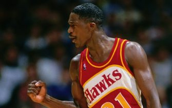 LOS ANGELES - 1987: Dominique Wilkins #21 of the Atlanta Hawks reacts during a game played circa 1987 at the LA Sports Arena in Los Angeles, California. NOTE TO USER: User expressly acknowledges and agrees that, by downloading and or using this photograph, User is consenting to the terms and conditions of the Getty Images License Agreement. Mandatory Copyright Notice: Copyright 1987 NBAE (Photo by Andrew D. Bernstein/NBAE via Getty Images)