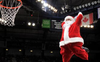 SACRAMENTO, CA - DECEMBER 21: Santa Clause dunks during the game between the Los Angeles Lakers and Sacramento Kings on December 21, 2014 at Sleep Train Arena in Sacramento, California. NOTE TO USER: User expressly acknowledges and agrees that, by downloading and or using this photograph, User is consenting to the terms and conditions of the Getty Images Agreement. Mandatory Copyright Notice: Copyright 2014 NBAE (Photo by Rocky Widner/NBAE via Getty Images)