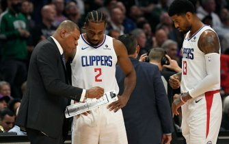LOS ANGELES, CA - NOVEMBER 20: Doc Rivers of the Los Angeles Clippers sets up a play with Kawhi Leonard #2 and Paul George #13 during overtime against Boston Celtics at Staples Center on November 20, 2019 in Los Angeles, California. NOTE TO USER: User expressly acknowledges and agrees that, by downloading and/or using this Photograph, user is consenting to the terms and conditions of the Getty Images License Agreement. (Photo by Kevork Djansezian/Getty Images)