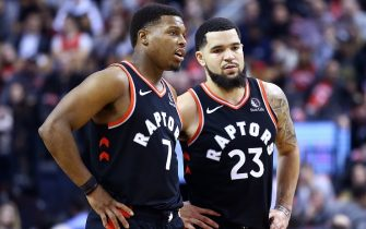 TORONTO, ON - DECEMBER 20:  Kyle Lowry #7 of the Toronto Raptors speaks with Fred VanVleet #23 during the second half of an NBA game against the Washington Wizards at Scotiabank Arena on December 20, 2019 in Toronto, Canada.  NOTE TO USER: User expressly acknowledges and agrees that, by downloading and or using this photograph, User is consenting to the terms and conditions of the Getty Images License Agreement.  (Photo by Vaughn Ridley/Getty Images)