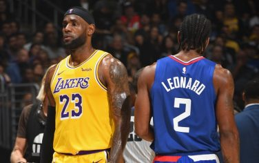 LOS ANGELES, CA - OCTOBER 22: LeBron James #23 of the Los Angeles Lakers and Kawhi Leonard #2 of the LA Clippers walk on the court on October 22, 2019 at STAPLES Center in Los Angeles, California. NOTE TO USER: User expressly acknowledges and agrees that, by downloading and/or using this Photograph, user is consenting to the terms and conditions of the Getty Images License Agreement. Mandatory Copyright Notice: Copyright 2019 NBAE (Photo by Andrew D. Bernstein/NBAE via Getty Images)