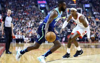 TORONTO, ON - DECEMBER 22:  Tim Hardaway Jr. #11 of the Dallas Mavericks dribbles the ball as Rondae Hollis-Jefferson #4 of the Toronto Raptors defends during the first half of an NBA game at Scotiabank Arena on December 22, 2019 in Toronto, Canada.  NOTE TO USER: User expressly acknowledges and agrees that, by downloading and or using this photograph, User is consenting to the terms and conditions of the Getty Images License Agreement.  (Photo by Vaughn Ridley/Getty Images)
