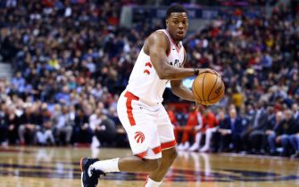 TORONTO, ON - DECEMBER 03:  Kyle Lowry #7 of the Toronto Raptors dribbles the ball during the second half of an NBA game against the Miami Heat at Scotiabank Arena on December 03, 2019 in Toronto, Canada.  NOTE TO USER: User expressly acknowledges and agrees that, by downloading and or using this photograph, User is consenting to the terms and conditions of the Getty Images License Agreement.  (Photo by Vaughn Ridley/Getty Images)