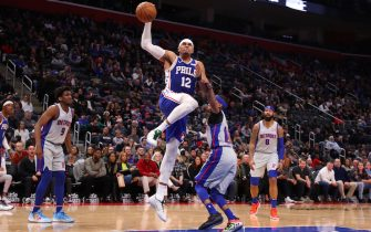DETROIT, MICHIGAN - DECEMBER 23: Tobias Harris #12 of the Philadelphia 76ers drives to the basket past Tim Frazier #12 of the Detroit Pistons during the second half at Little Caesars Arena on December 23, 2019 in Detroit, Michigan. Philadelphia won the game 125-109. NOTE TO USER: User expressly acknowledges and agrees that, by downloading and or using this photograph, User is consenting to the terms and conditions of the Getty Images License Agreement. (Photo by Gregory Shamus/Getty Images)