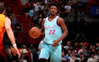 MIAMI, FL - DECEMBER 23: Jimmy Butler #22 of the Miami Heat handles the ball during a game against the Utah Jazz on December 23, 2019 at American Airlines Arena in Miami, Florida. NOTE TO USER: User expressly acknowledges and agrees that, by downloading and or using this Photograph, user is consenting to the terms and conditions of the Getty Images License Agreement. Mandatory Copyright Notice: Copyright 2019 NBAE (Photo by Issac Baldizon/NBAE via Getty Images)