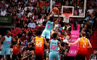 MIAMI, FL - DECEMBER 23: Derrick Jones Jr. #5 of the Miami Heat goes up for a dunk during a game against the Utah Jazz on December 23, 2019 at American Airlines Arena in Miami, Florida. NOTE TO USER: User expressly acknowledges and agrees that, by downloading and or using this Photograph, user is consenting to the terms and conditions of the Getty Images License Agreement. Mandatory Copyright Notice: Copyright 2019 NBAE (Photo by Issac Baldizon/NBAE via Getty Images)
