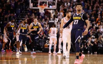 PHOENIX, ARIZONA - DECEMBER 23: Jamal Murray #27 of the Denver Nuggets reacts after putting up a shot over Aron Baynes #46 of the Phoenix Suns during the final moments of the second half of the NBA game at Talking Stick Resort Arena on December 23, 2019 in Phoenix, Arizona. The Nuggets defeated the Suns 113-111. (Photo by Christian Petersen/Getty Images)