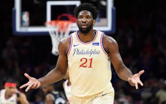PHILADELPHIA, PENNSYLVANIA - DECEMBER 25: Joel Embiid #21 of the Philadelphia 76ers reacts after scoring during the first half of the game against the Milwaukee Bucks at Wells Fargo Center on December 25, 2019 in Philadelphia, Pennsylvania. NOTE TO USER: User expressly acknowledges and agrees that, by downloading and or using this photograph, User is consenting to the terms and conditions of the Getty Images License Agreement. (Photo by Sarah Stier/Getty Images)