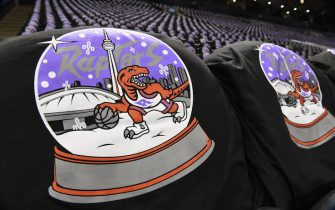 TORONTO, CANADA - DECEMBER 25: A close up of t-shirts placed out for fans prior to a game between the Toronto Raptors and the Boston Celtics on December 25, 2019 at the Scotiabank Arena in Toronto, Ontario, Canada.  NOTE TO USER: User expressly acknowledges and agrees that, by downloading and or using this Photograph, user is consenting to the terms and conditions of the Getty Images License Agreement.  Mandatory Copyright Notice: Copyright 2019 NBAE (Photo by Ron Turenne/NBAE via Getty Images)