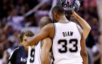 SAN ANTONIO, TX - JUNE 15:  Boris Diaw #33 and Tony Parker #9 of the San Antonio Spurs celebrate against the Miami Heat during Game Five of the 2014 NBA Finals at the AT&T Center on June 15, 2014 in San Antonio, Texas. NOTE TO USER: User expressly acknowledges and agrees that, by downloading and or using this photograph, User is consenting to the terms and conditions of the Getty Images License Agreement.  (Photo by Andy Lyons/Getty Images)
