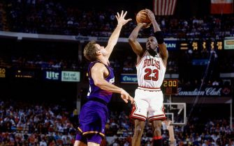 CHICAGO - JUNE 18:  Michael Jordan #23 of the Chicago Bulls attempts a shot against Dan Majerle #9 of the Phoenix Suns in Game Five of the 1993 NBA Finals on June 18, 1993 at the Chicago Stadium in Chicago, Illinois. The Suns won 108-98. NOTE TO USER: User expressly acknowledges and agrees that, by downloading and/or using this Photograph, user is consenting to the terms and conditions of the Getty Images License Agreement. Mandatory Copyright Notice: Copyright 1993 NBAE  (Photo by Nathaniel S. Butler/NBAE via Getty Images)