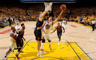 OAKLAND, CA - JUNE 4: Stephen Curry #30 of the Golden State Warriors shoots against Timofey Mozgov #20 of the Cleveland Cavaliers during Game One of the 2015 NBA Finals on June 4, 2015 at Oracle Arena in Oakland, California. NOTE TO USER: User expressly acknowledges and agrees that, by downloading and or using this photograph, user is consenting to the terms and conditions of Getty Images License Agreement. Mandatory Copyright Notice: Copyright 2015 NBAE (Photo by Andrew D. Bernstein/NBAE via Getty Images)
