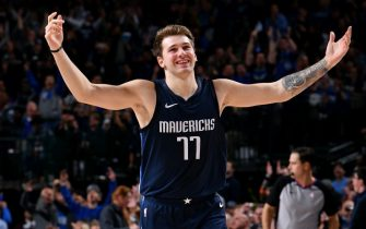 DALLAS, TX - DECEMBER 4: Luka Doncic #77 of the Dallas Mavericks smiles during the game against the Minnesota Timberwolves on December 04, 2019 at the American Airlines Center in Dallas, Texas. NOTE TO USER: User expressly acknowledges and agrees that, by downloading and or using this photograph, User is consenting to the terms and conditions of the Getty Images License Agreement. Mandatory Copyright Notice: Copyright 2019 NBAE (Photo by Glenn James/NBAE via Getty Images)