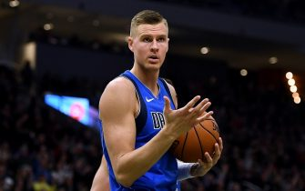MILWAUKEE, WISCONSIN - DECEMBER 16:  Kristaps Porzingis #6 of the Dallas Mavericks reacts to an officials call during the first half of a game against the Milwaukee Bucks at Fiserv Forum on December 16, 2019 in Milwaukee, Wisconsin. NOTE TO USER: User expressly acknowledges and agrees that, by downloading and or using this photograph, User is consenting to the terms and conditions of the Getty Images License Agreement. (Photo by Stacy Revere/Getty Images)