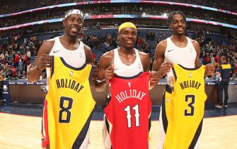 NEW ORLEANS, LA - DECEMBER 28:  The Holiday brothers exchange jerseys and pose for a photo following the game on December 28, 2019 at the Smoothie King Center in New Orleans, Louisiana. NOTE TO USER: User expressly acknowledges and agrees that, by downloading and or using this Photograph, user is consenting to the terms and conditions of the Getty Images License Agreement. Mandatory Copyright Notice: Copyright 2019 NBAE (Photo by Layne Murdoch Jr./NBAE via Getty Images)