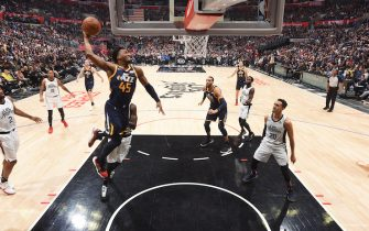 LOS ANGELES, CA - DECEMBER 28: Donovan Mitchell #45 of the Utah Jazz dunks the ball against the LA Clippers on December 28, 2019 at STAPLES Center in Los Angeles, California. NOTE TO USER: User expressly acknowledges and agrees that, by downloading and/or using this Photograph, user is consenting to the terms and conditions of the Getty Images License Agreement. Mandatory Copyright Notice: Copyright 2019 NBAE (Photo by Andrew D. Bernstein/NBAE via Getty Images)