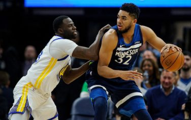 MINNEAPOLIS, MN - MARCH 11: Draymond Green #23 of the Golden State Warriors defends against Karl-Anthony Towns #32 of the Minnesota Timberwolves during the game on March 11, 2018 at the Target Center in Minneapolis, Minnesota. NOTE TO USER: User expressly acknowledges and agrees that, by downloading and or using this Photograph, user is consenting to the terms and conditions of the Getty Images License Agreement. (Photo by Hannah Foslien/Getty Images)