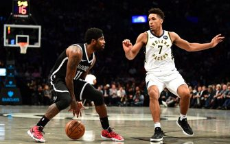 NEW YORK, NEW YORK - OCTOBER 30: Kyrie Irving #11 of the Brooklyn Nets dribbles the ball as Malcolm Brogdon #7 of the Indiana Pacers guards him during the first half of their game at Barclays Center on October 30, 2019 in the Brooklyn borough of New York City. NOTE TO USER: User expressly acknowledges and agrees that, by downloading and or using this Photograph, user is consenting to the terms and conditions of the Getty Images License Agreement.  (Photo by Emilee Chinn/Getty Images)
