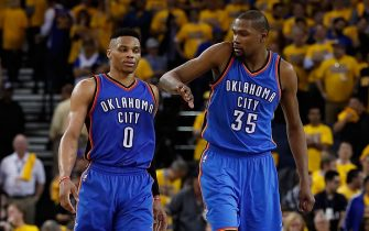 OAKLAND, CA - MAY 16:  Kevin Durant #35 (R) of the Oklahoma City Thunder celebrates with Russell Westbrook #0 during the final moments of game one of the NBA Western Conference Finals against the Golden State Warriors at ORACLE Arena on May 16, 2016 in Oakland, California. The Thunder defeated the Warriors 108-102. NOTE TO USER: User expressly acknowledges and agrees that, by downloading and or using this photograph, User is consenting to the terms and conditions of the Getty Images License Agreement.  (Photo by Christian Petersen/Getty Images)