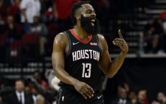 HOUSTON, TEXAS - DECEMBER 31: James Harden #13 of the Houston Rockets reacts after making a three-point basket against the Denver Nuggets during the fourth quarter at Toyota Center on December 31, 2019 in Houston, Texas. NOTE TO USER: User expressly acknowledges and agrees that, by downloading and/or using this photograph, user is consenting to the terms and conditions of the Getty Images License Agreement. (Photo by Bob Levey/Getty Images)