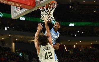 MILWAUKEE, WISCONSIN - JANUARY 01:  Jarrett Culver #23 of the Minnesota Timberwolves dunks over Robin Lopez #42 of the Milwaukee Bucks during the second half at Fiserv Forum on January 01, 2020 in Milwaukee, Wisconsin. NOTE TO USER: User expressly acknowledges and agrees that, by downloading and or using this photograph, User is consenting to the terms and conditions of the Getty Images License Agreement.  (Photo by Stacy Revere/Getty Images)