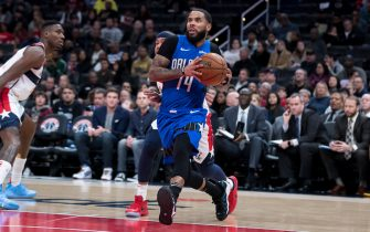 WASHINGTON, DC - JANUARY 01: D.J. Augustin #14 of the Orlando Magic drives to the basket against the Washington Wizards during the first half at Capital One Arena on January 1, 2020 in Washington, DC. NOTE TO USER: User expressly acknowledges and agrees that, by downloading and or using this photograph, User is consenting to the terms and conditions of the Getty Images License Agreement. (Photo by Scott Taetsch/Getty Images)