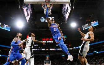 SAN ANTONIO, TX - JANUARY 2:  Shai Gilgeous-Alexander #2 of the Oklahoma City Thunder flies past Bryn Forbes #11 of the San Antonio Spurs during second half action at AT&T Center on January 2, 2020 in San Antonio, Texas.  Oklahoma City defeated the San Antonio Spurs 109-103. NOTE TO USER: User expressly acknowledges and agrees that , by downloading and or using this photograph, User is consenting to the terms and conditions of the Getty Images License Agreement. (Photo by Ronald Cortes/Getty Images)