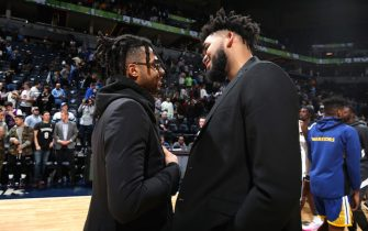 MINNEAPOLIS, MN -  JANUARY 2: D'Angelo Russell #0 of the Golden State Warriors and Karl-Anthony Towns #32 of the Minnesota Timberwolves greet each other after a game on January 2, 2020 at Target Center in Minneapolis, Minnesota. NOTE TO USER: User expressly acknowledges and agrees that, by downloading and or using this Photograph, user is consenting to the terms and conditions of the Getty Images License Agreement. Mandatory Copyright Notice: Copyright 2020 NBAE (Photo by David Sherman/NBAE via Getty Images)