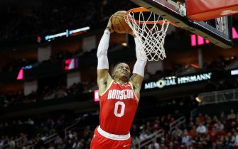 HOUSTON, TX - JANUARY 03:  Russell Westbrook #0 of the Houston Rockets goes up for a dunk in the second half against the Philadelphia 76ers at Toyota Center on January 3, 2020 in Houston, Texas.  NOTE TO USER: User expressly acknowledges and agrees that, by downloading and or using this photograph, User is consenting to the terms and conditions of the Getty Images License Agreement.  (Photo by Tim Warner/Getty Images)