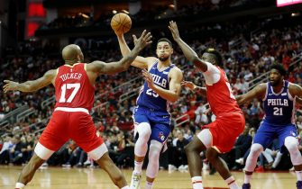 HOUSTON, TX - JANUARY 03:  Ben Simmons #25 of the Philadelphia 76ers drives to the basket defended by PJ Tucker #17 of the Houston Rockets and Clint Capela #15 in the first half at Toyota Center on January 3, 2020 in Houston, Texas.  NOTE TO USER: User expressly acknowledges and agrees that, by downloading and or using this photograph, User is consenting to the terms and conditions of the Getty Images License Agreement.  (Photo by Tim Warner/Getty Images)