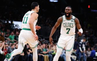 BOSTON, MASSACHUSETTS - JANUARY 03: Jaylen Brown #7 of the Boston Celtics celebrates with Enes Kanter #11 after Kanter scored against the Atlanta Hawks  at TD Garden on January 03, 2020 in Boston, Massachusetts. The Celtics defeat the Hawks 109-106.  (Photo by Maddie Meyer/Getty Images)